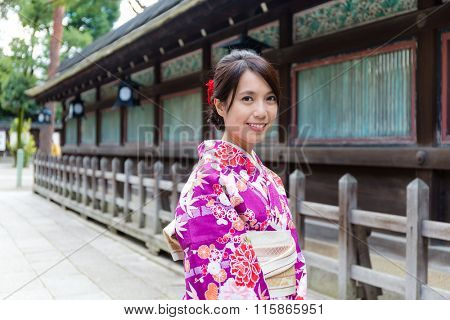 Asian Woman wearing the kimono dress at temple