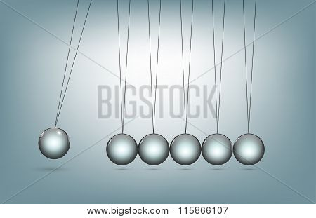 newton's cradle silver balls viewed from the front