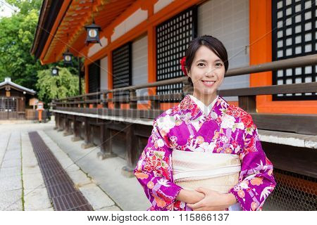 Japanese Woman with kimono dress at traditional temple
