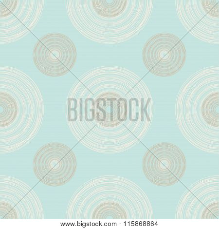 Large And Small Brown And Ivory Circles Of Multiple Lines On Pastel Mint Background