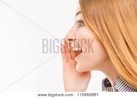 Close Up Side-view Portrait Of Girl Telling A Secret