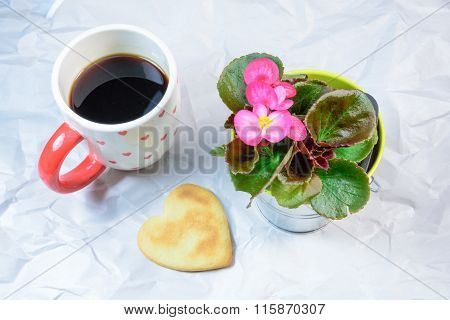 Homemade Cookies,heart Shape,begonia  And A Cup Of Black Coffee