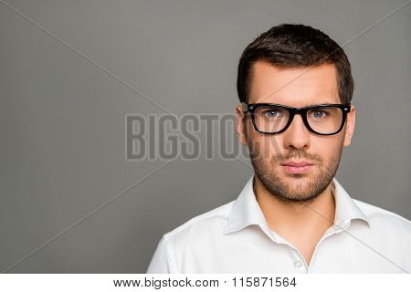 Close Up Photo Of Serious Smart Man In Glasses