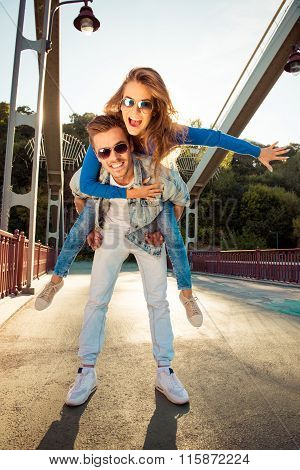 Positive Funny Couple In Love On The Bridge With Glasses