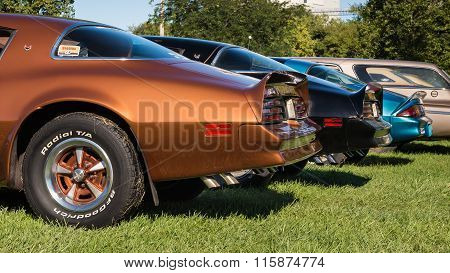 Two Pontiac Firebird Trans AMs and a Chevrolet Camaro Z/28