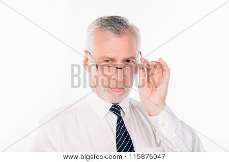 Old Strict Businessman In Shirt And Tie Holding His Glasses