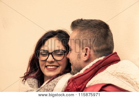 Young Happy Couple Of Lovers At Beginning Of Love Story - Handsome Hipster Man Whispers