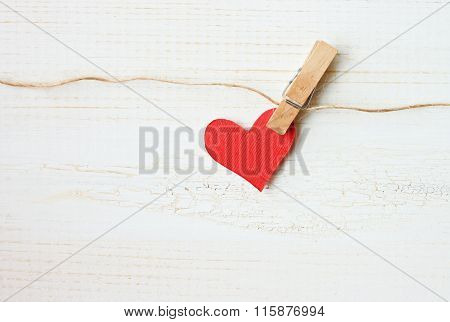 red heart pinned on twine