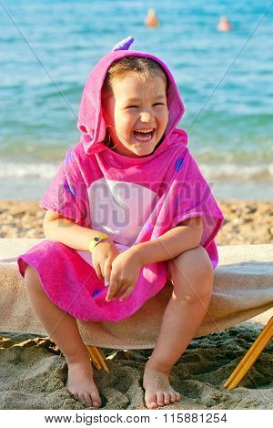 Happy Child Wearing A Beach Towel