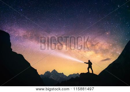 Man in front of the Milky Way