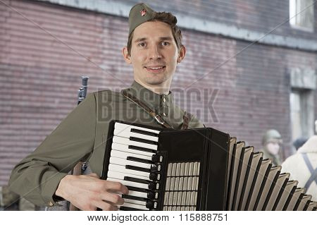 Soviet Soldier Playing The Accordion Outdoors