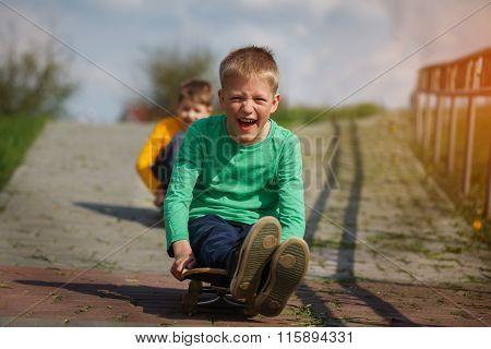 Active Childhood. Little Man Skateboarding.