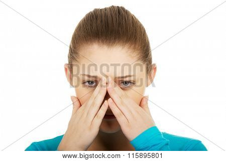Teen woman with sinus pain.