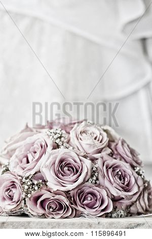 A Coloured Macro Photo Of A Detailed Bouquet With Pink Roses, White Small Flowers And A Fake Diamond