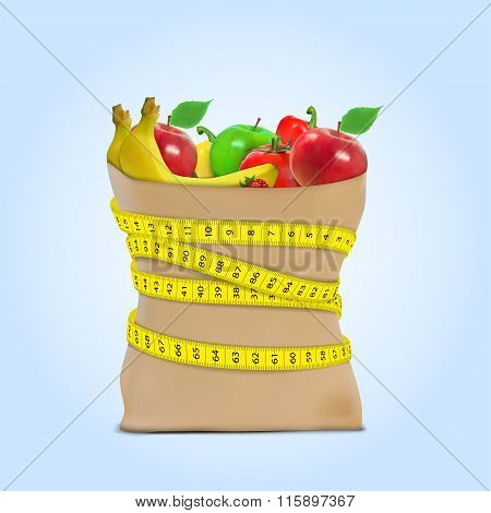 Fresh vegetables in a paper grocery bag with measuring tape. Concept of diet.