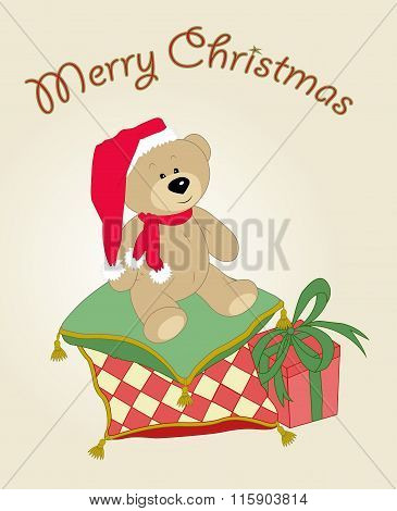 Christmas teddy bear with a gift