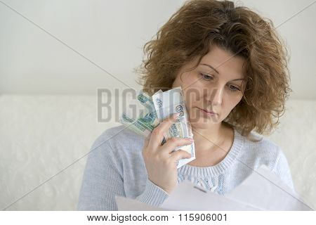 adult woman with receipts and Russian money