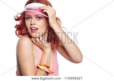 Bright makeup. Beauty Girl Portrait holding Colorful lollipop. Pink cap.