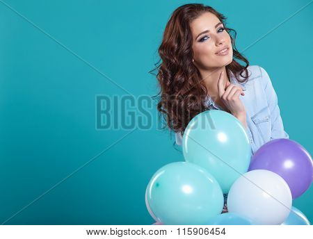 Woman with balloons in studio