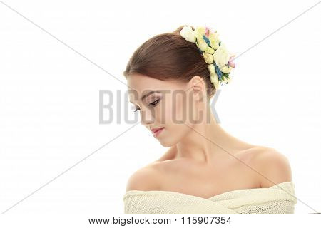 Closeup beauty portrait of young adorable brunette woman with flower headpiece demonstrates trendy m