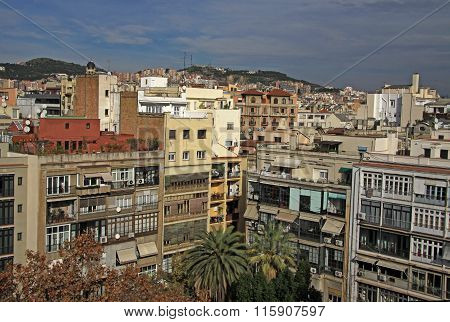 Barcelona, Catalonia, Spain - December 13, 2011: Multi-storey Buildings And Roofs In Barcelona