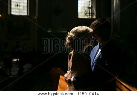 bride and groom illuminated by light