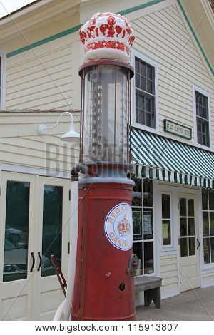 An old gas pump outside a general store