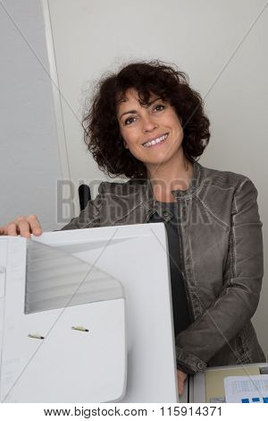 Confident Woman At The Copy Machine, It's Her Job