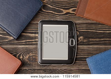 E-book reader close-up on wooden background