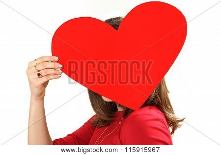The Effective Young Woman In A Red Dress With Red Heart Valentine's Day Card In Hands.