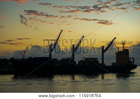 The container vessel is loaded and unloaded at Labuan port in the morning