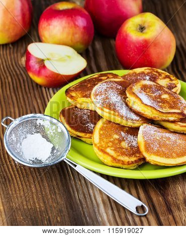 Pancakes With Apples On A Green Plate