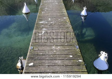 Close Up Of Old Wooden Pontoon On Annecy Lake