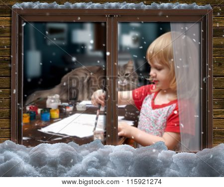Outside, a small child draws a brush and paints on a sheet of paper.