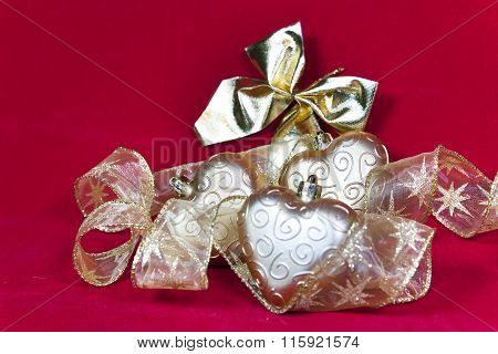 gold New Year's hearts and decorative ribbon