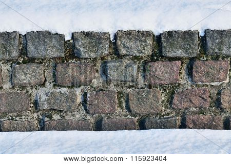 Ancient Stone Wall In The Snow