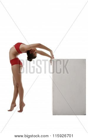 Image of flexible gymnast arched her back to cube