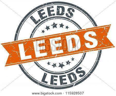 Leeds orange round grunge vintage ribbon stamp