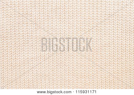 Abstract Knitted Background. Wool Beige Sweater Texture. Close Up Picture Of  Knitted Pattern.