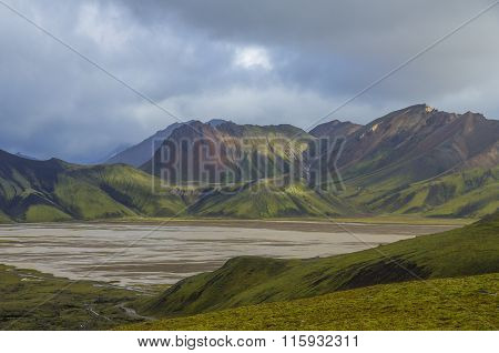 Lake and moss-covered volcanic mountains. Landmannalaugar. Iceland