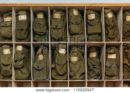 Bags Of Gas Mask In Wooden Rack