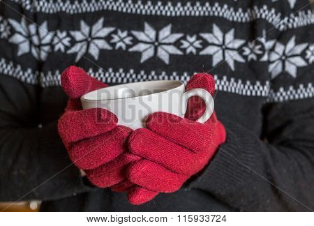 Closeup Of Hands Holding Hot Coffee Cup