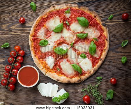 Delicious italian pizza served on wooden table. Top view.