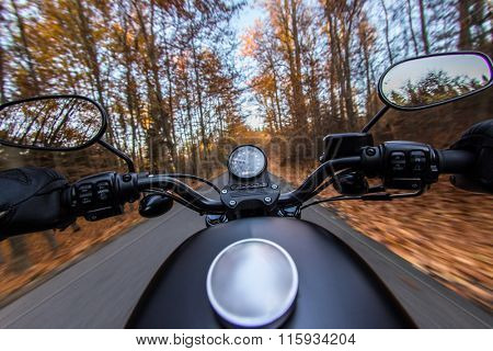 The view over the handlebars of a speeding motorcycle