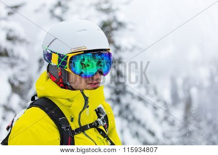 Portrait of skier in high mountains during sunny day.