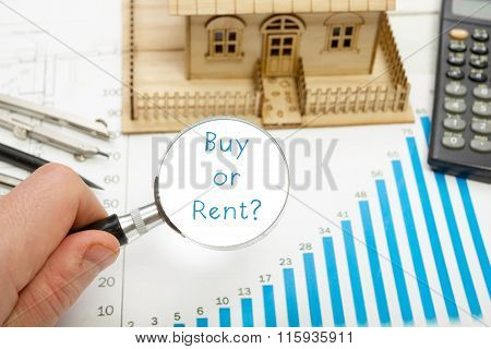 Magnifying glass with  text Buy or Rent in a concept image