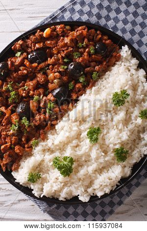 Cuban Picadillo A La Habanera With Rice Close-up. Vertical Top View