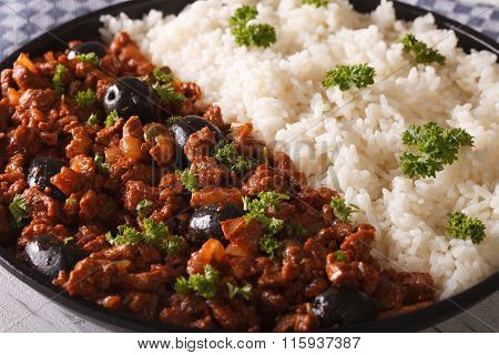 Latin American Cuisine: Picadillo A La Habanera With A Side Dish Of Rice