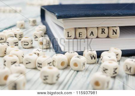 LEARN word written on wood block
