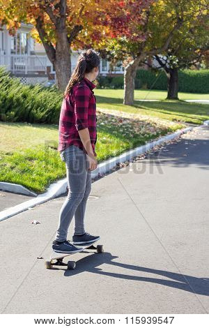 Women Riding Longboard Skateboard Outdoor